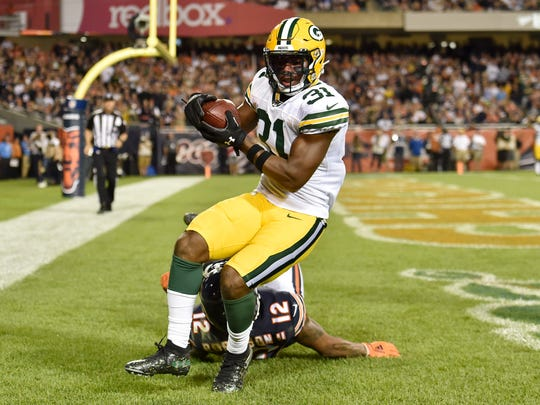 Sep 5, 2019; Chicago, IL, USA; Green Bay Packers strong safety Adrian Amos (31) intercepts the football in the fourth quarter against Chicago Bears wide receiver Allen Robinson (12) at Soldier Field. Mandatory Credit: Quinn Harris-USA TODAY Sports