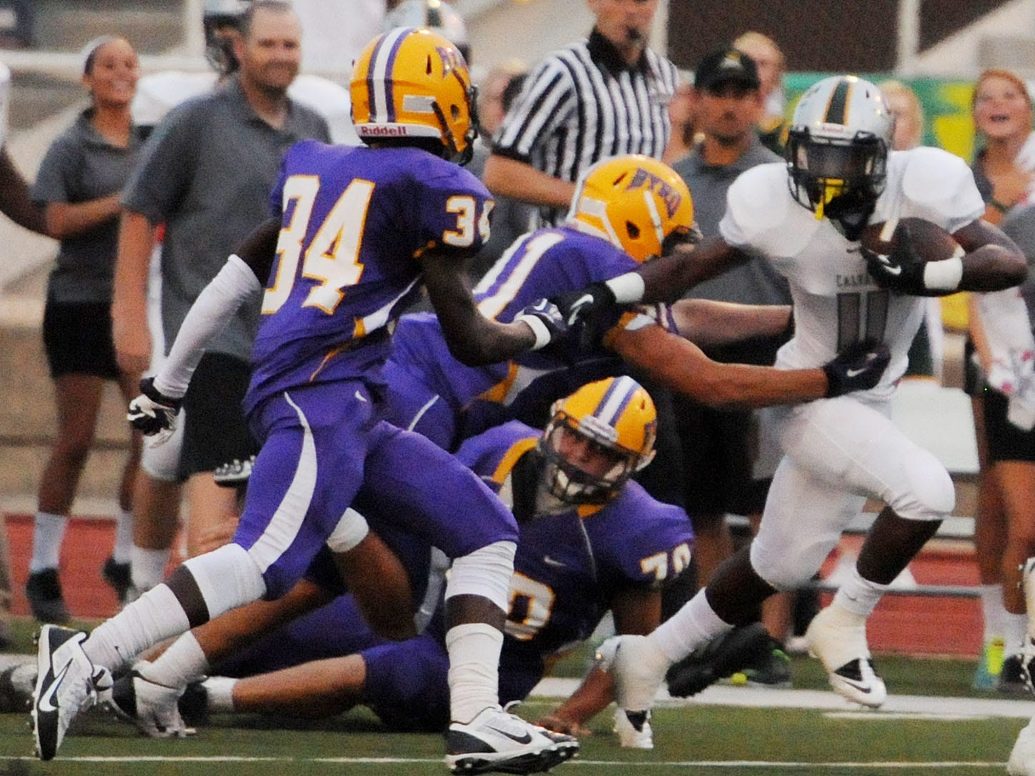 Calvary's Shun Brown (11) tries to get away from the Byrd defense this past season in a 48-21 Yellow Jackets' win at Lee Hedges Stadium.