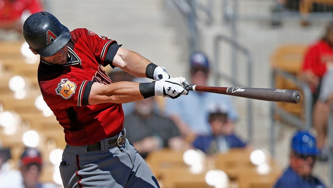 Arizona Diamondbacks shortstop Chris Owings follows through on this home run swing against the Chicago White Sox during the second inning of a spring training baseball game Thursday, March 9, 2017, in Glendale, Ariz.