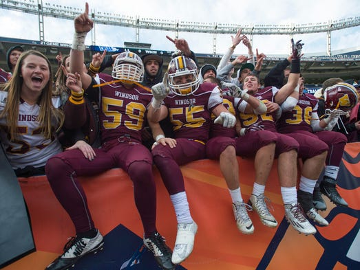 The Windsor High School football team celebrates with