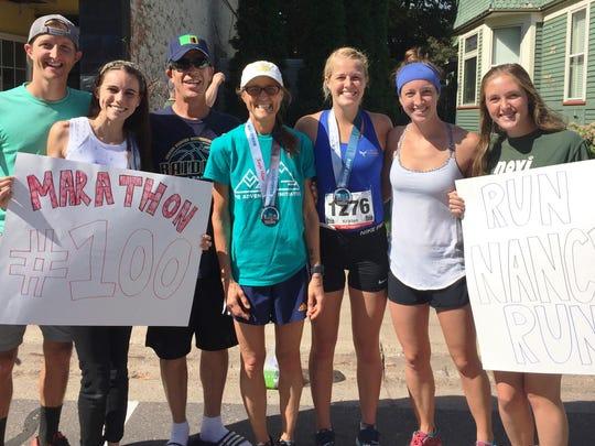 Nancy Schubring (middle), completed her 100th marathon