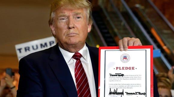 Donald Trump holds his GOP loyalty pledge at Trump