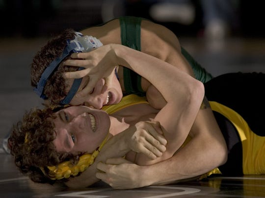 Raritan's Phil O'Hara squeezes hard as he tries for backpoints against St. John Vianney's Dan Smith, with O'Hara winning by technical fall in the 2004 match..