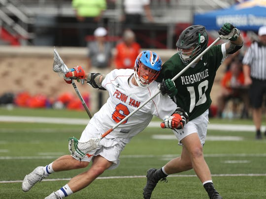 Penn Yan's Conner Fingar (8) tries to fight through Pleasantville's Charlie McPhee in the Class D state final last June.