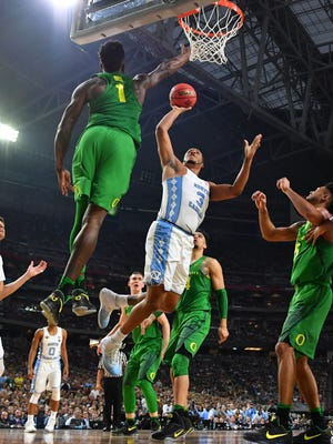 North Carolina Tar Heels forward Kennedy Meeks (3) shoots defended by Oregon Ducks forward Jordan Bell (1) in the semifinals of the 2017 NCAA Men's Final Four at University of Phoenix Stadium.
