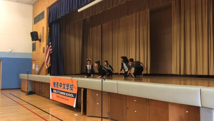 William Liu, and his students perform a hip-hop routine