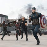 """Falcon (Anthony Mackie), Ant-Man (Paul Rudd), Hawkeye (Jeremy Renner), Captain America (Chris Evans), Scarlet Witch (Elizabeth Olsen) and Winter Soldier (Sebastian Stan) race into battle against Iron Man's group in """"Captain America: Civil War."""""""