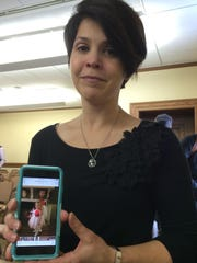 Amy Thomson of Butte holds a picture of her daughter who was 2 1/2 months old at the time of her air ambulance flight.