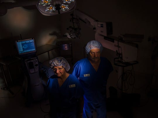 The Eye Surgery Center RN and clinical administrator Mary Clairmont and Tony Bianchi, surgical technician, hope proposed regulations of surgical centers like theirs won't leave them in the dark. New taxes and fees could add hundreds of thousands of dollars to expenses surgery centers have to pay.