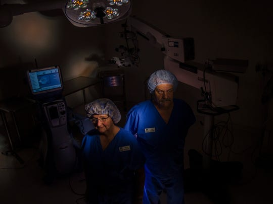 Vermont Eye Laser RN and clinical administrator Mary Clairmont and Tony Bianchi, surgical technician, hope proposed regulations of surgical centers like theirs won't leave them in the dark. New taxes and fees could add hundreds of thousands of dollars to expenses surgery centers have to pay.