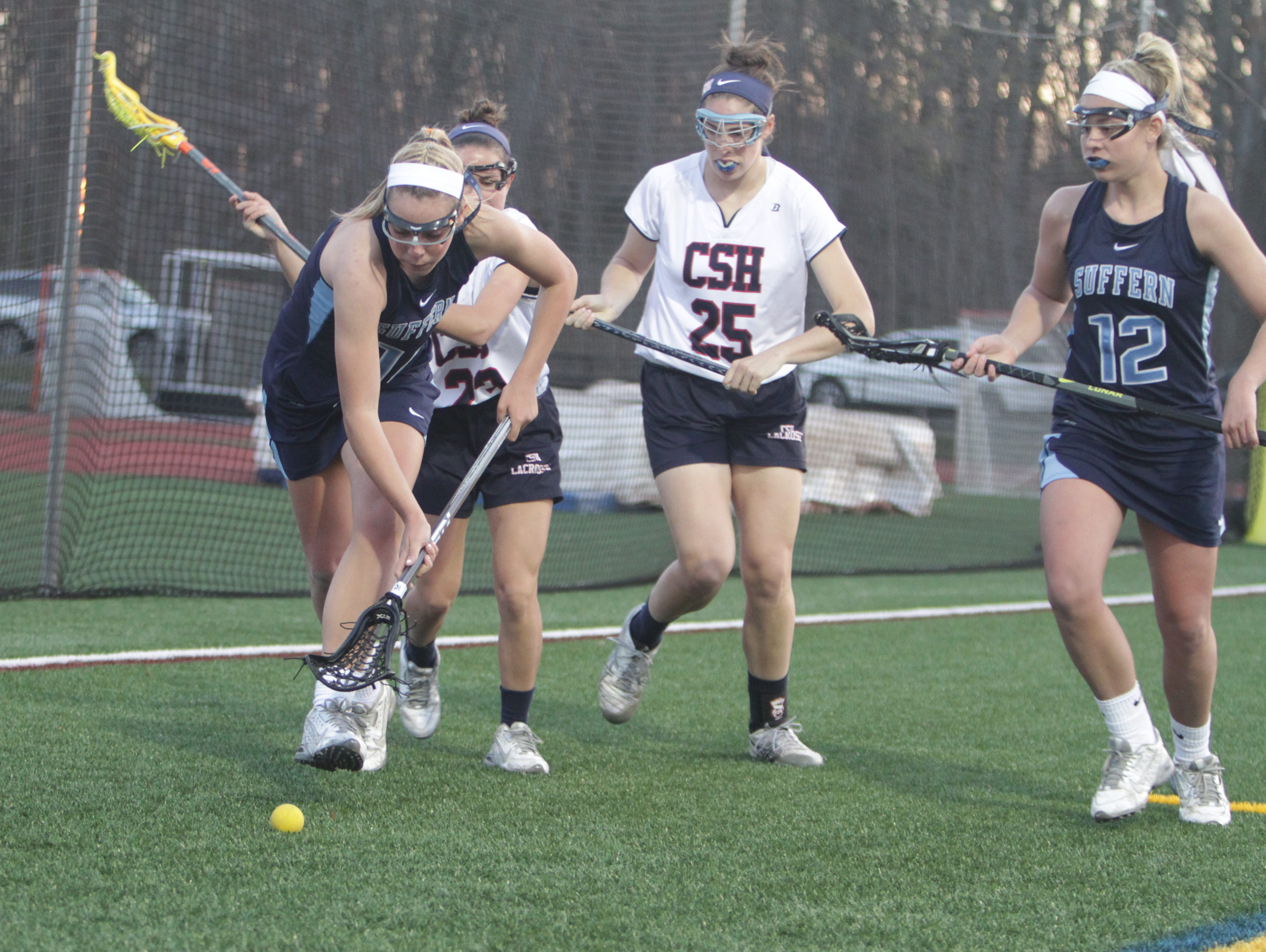 Suffern's Reilly Drab goes after a ground ball, with older sister Jordan (12) looking on, during a girls lacrosse game between Suffern and Cold Spring Harbor in the Gains for Brains Lax Showcase at Cold Spring Harbor High School on Saturday, April 16th, 2016. Cold Spring Harbor won 13-11.