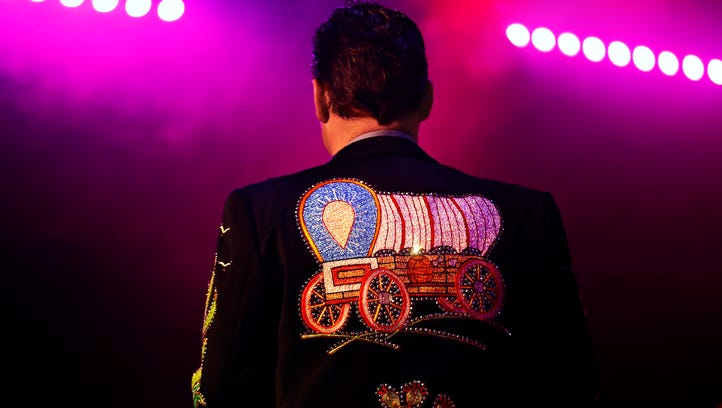 Master of ceremonies Mike Patrick exits the stage during a Grand Jubilee performance at Grand Country Music Hall in Branson, Mo. on Jan. 26, 2017.