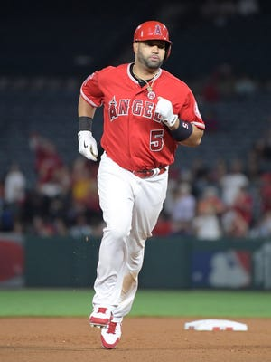 Los Angeles Angels designated hitter Albert Pujols (5) rounds the bases after hitting a two-run home run in the seventh inning against the Texas Rangers for his 610th career home run to move into eighth on the all-time home run list and the most by a foreign-born player during a MLB baseball game at Angel Stadium of Anaheim.