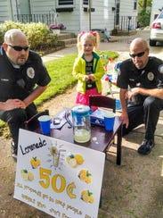 Hales Corners Detective Justin Landry (left) and Officer