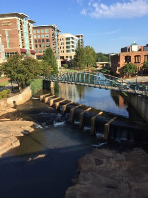 Hotels and other businesses in downtown Greenville, S.C., line the Reedy River, forming a Riverwalk. The Riverwalk is part of Greenville CountyÕs Swamp Rabbit Trail.