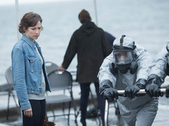 Nora (Carrie Coon) prepares to enter a device that
