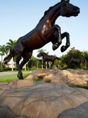 The three final bronze horse sculptures, which had been in storage for nearly 25 years, were quietly installed just this year at the entrance of Lely Resort at Collier Boulevard and Grand Lely Drive. Pictured are the horses early Thursday August 3, 2017 in East Naples.