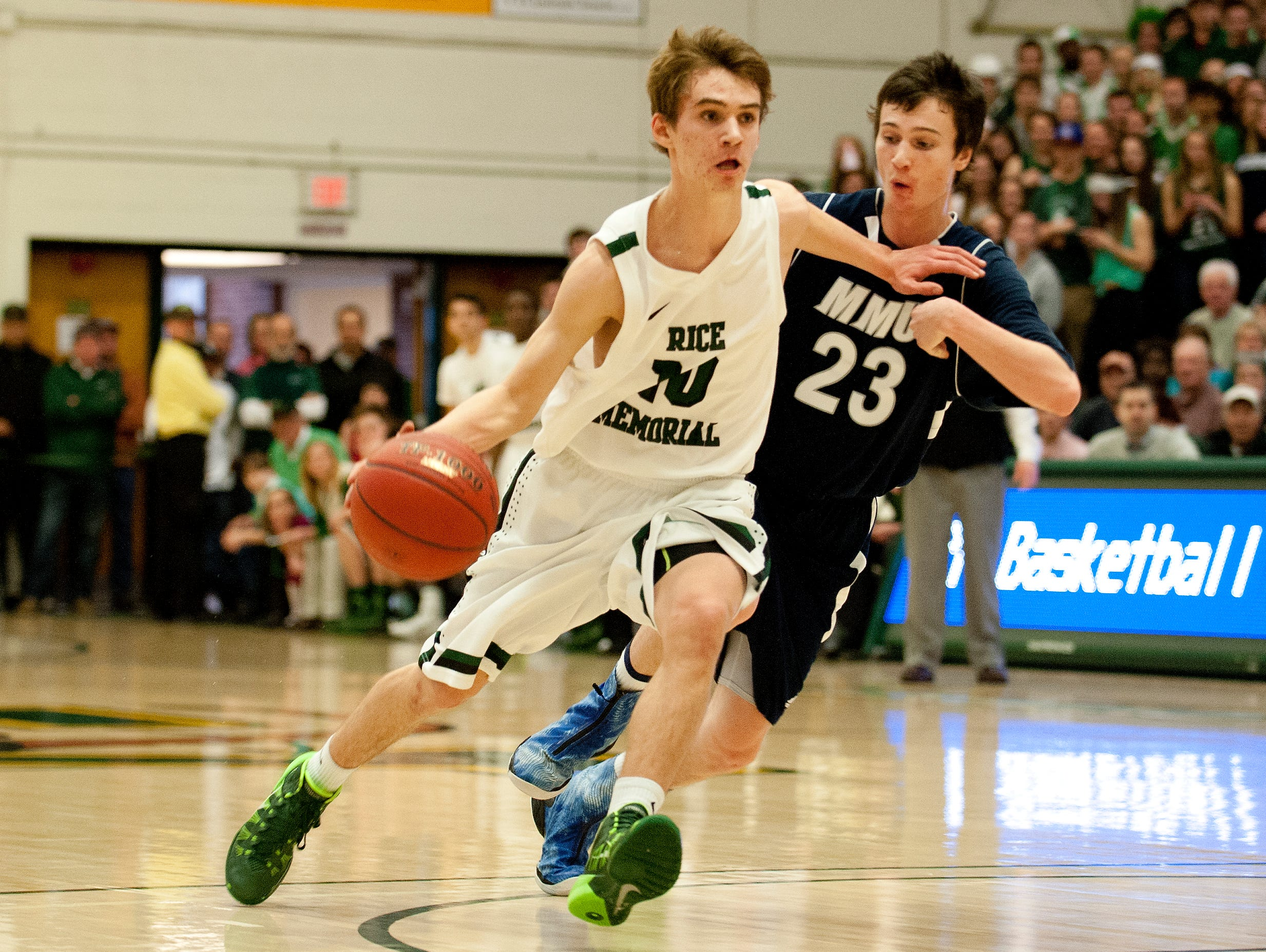 Rice's Tommy Fitzgerald drives pasta defender during the Division I boys basketball championship game in March.