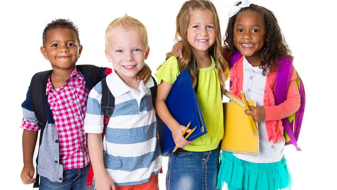 A group of diverse elementary age kids. Isolated on a white background