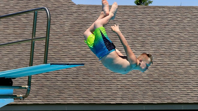 Josh Wooten, 11, flies off the high dive at the Salt City Splash on the first day the pool was open Sunday in Carey Park.