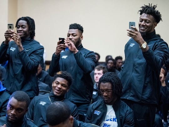 Middle Tennessee State University football players take photos as senior members of the MTSU football team are given a graduation ceremony at the team hotel in Montgomery, Ala. on Friday December 15, 2017.