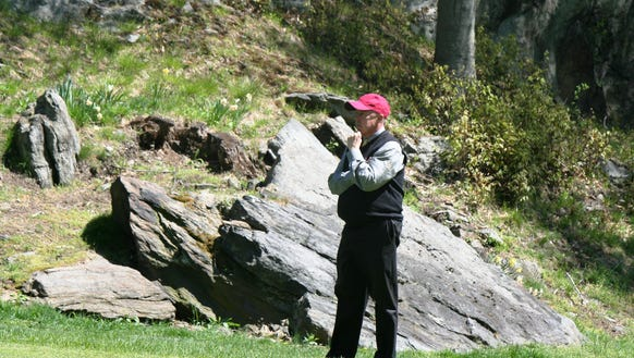 Former Met PGA executive director Charlie Robson strikes his trademark pose as he watches a semifinal match at the Westchester PGA Match Play Championship in 2013.