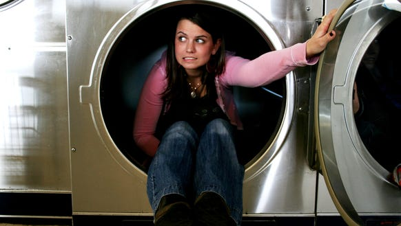 Why Your Washing Machine Smells And How To Clean It