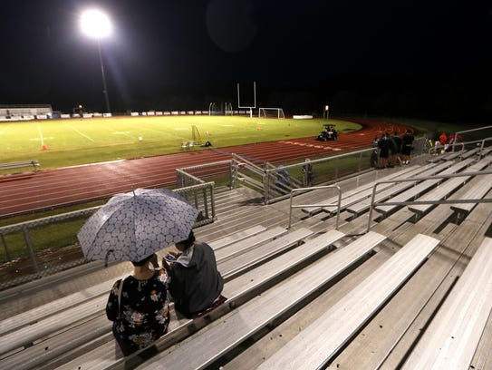 People wait in the stands of Chiles football stadium