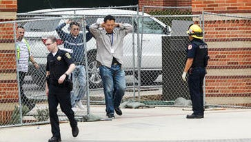 People are escorted by emergency personnel away from the scene of a fatal shooting at the University of California, Los Angeles, Wednesday, June 1, 2016, in Los Angeles. (AP Photo/Ringo H.W. Chiu)
