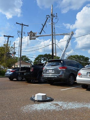 Vehicles were damaged by fire after power lines fell.