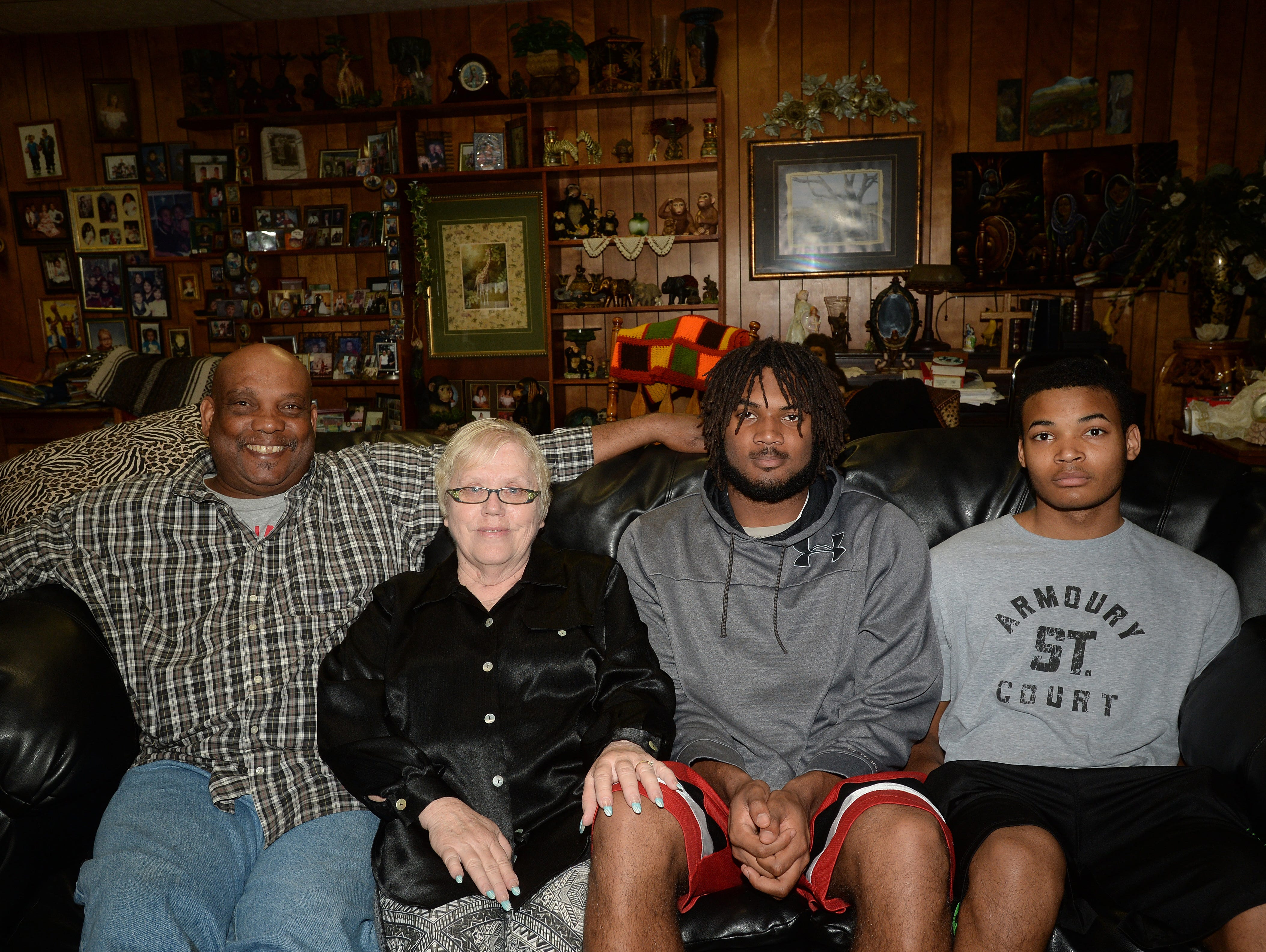 Kiante Enis with his grandfather, Dwight Enis, left; grandmother, Judy Enis; and brother, Boo Enis, Saturday, April 30, 2016, at their home in Saratoga, Ind.