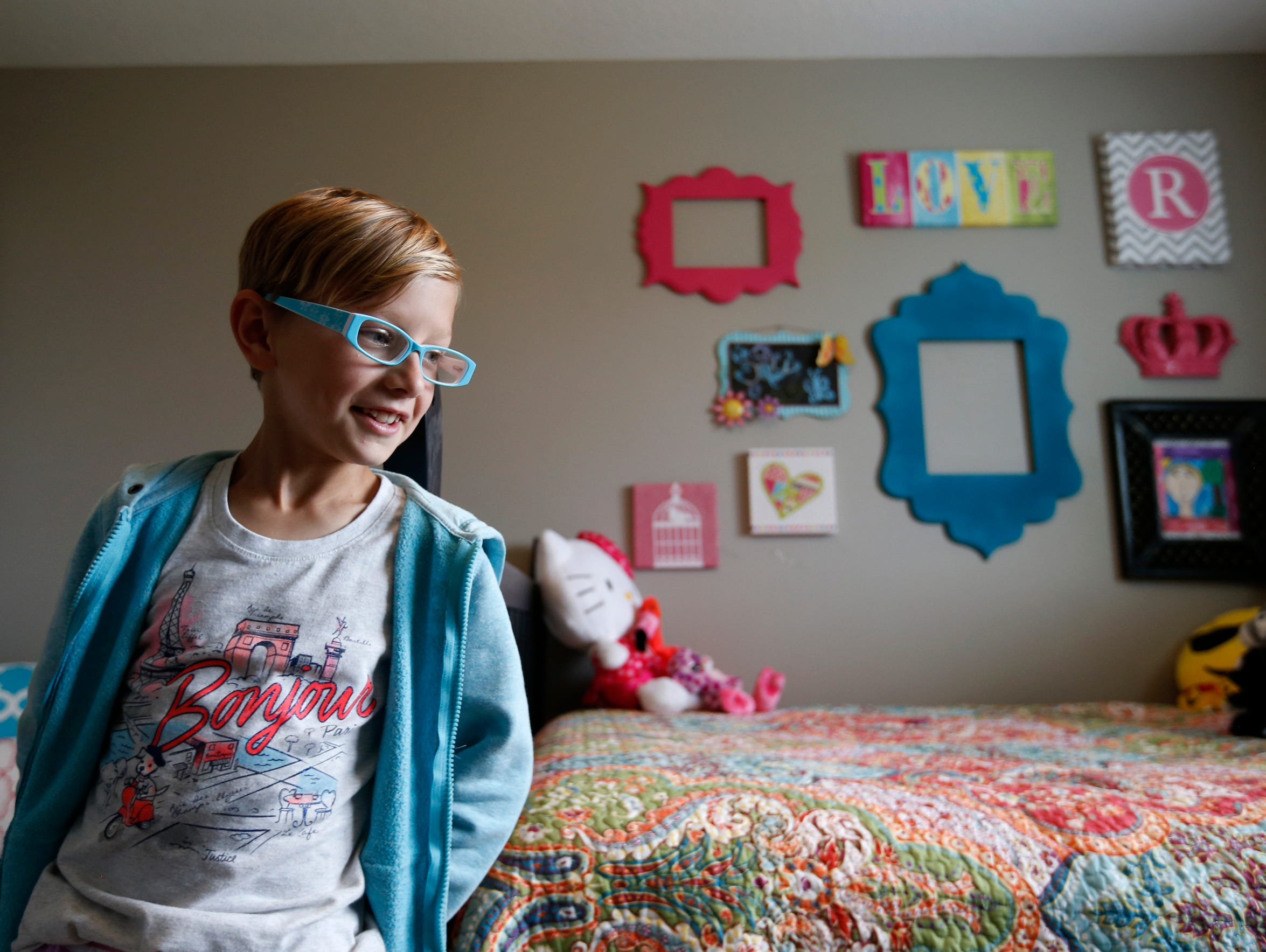Ryland Kelting, 9, with his walls decorated in traditionally