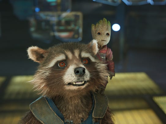 Rocket Raccoon (voice of Bradley Cooper, left) and