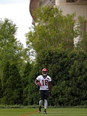 Cincinnati Bengals wide receiver A.J. Green (18) walks down the field during OTAs at Paul Brown Stadium.