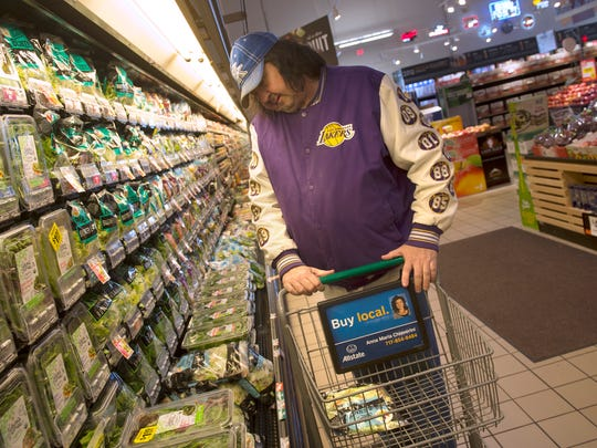 Frederick Kissinger looks through the salad section of the Giant store in Delco Plaza in  West Manchester Township. He took the free shuttle bus Giant is sponsoring since closing its store on West Market Street in West York. The thrice-weekly service started Wednesday.