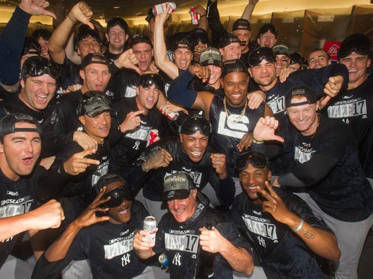 New York Yankees celebrate in the locker room after