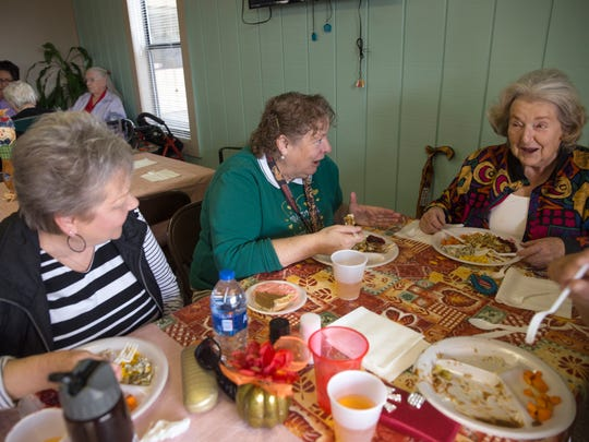 Apple Ridge Apartments residents Marsha Males, left, Maggie Scott and Pat Fleming enjoy a dinner cooked by Hermosa Middle School students Thursday in Farmington.