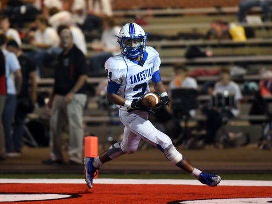 Zanesville's Julius Murphy runs for a touchdown against