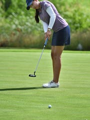 Alison Gastelum putts on No. 4 as she competes in the opening round of the 62nd Annual Texas-Oklahoma Junior Golf Tournament Monday at the Wichita Falls Country Club.