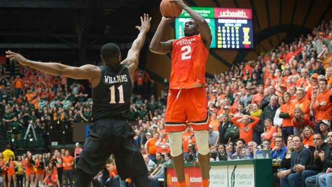 CSU forward Emmanuel Omogbo puts up his winning 3-point shot over D'Erryl Williams of San Diego State during a Feb. 25 game at Moby Arena. Omogbo will participate in the Portsmouth Invitational this week along with 63 other top NBA draft prospects.