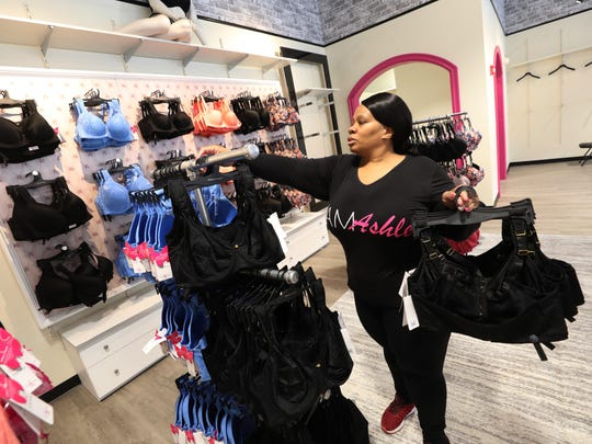 Aretha Blake of Harlem, a buyer with Ashley Stewart organizes bras in one of the areas of the store that is set up for the open of their new store in Newark.