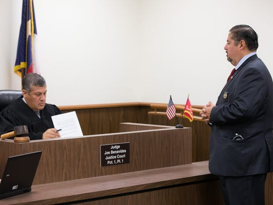 Lawyer Joe Flores (right) files a motion Tuesday, Oct. 10, 2017, with Nueces County Justice of the Peace Precinct 1, Place 1, Judge Joe Benavides. Flores said his dual careers as attorney and nurse practitioner go hand-in-hand.