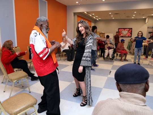 Bassie Friedman, director of business development at Marquis Home Care, dances with Edward Lee Artis, during chair aerobics at the Friendship Adult Day Center, where some of her clients from Marquis attend, April 30, 2018 in Spring Valley.