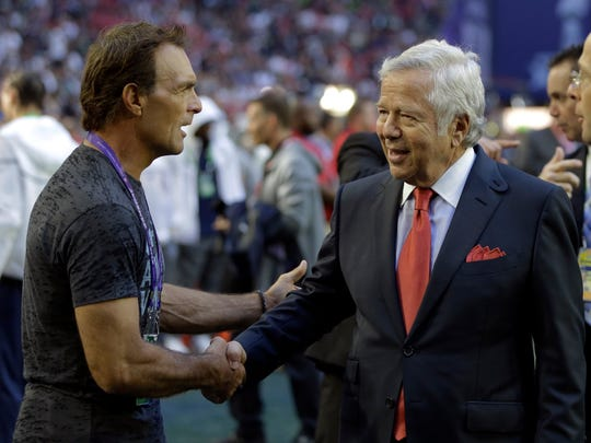 New England Patriots owner Robert Kraft, right, greets