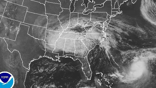 A satellite image shows Jose (lower right) spinning in the western Atlantic Ocean on  Sept. 12, 2017. The remnants of Irma are over the east-central U.S.