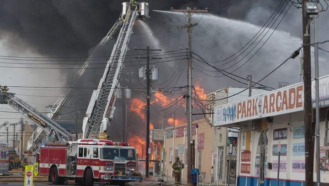Firefighters battle a fire that  destoyed a major portion of the boardwalk in Seaside Park and Seaside Heights, N.J., on Sept. 12, 2013.