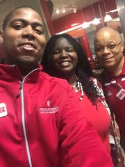 Treon McClendon (left) considers Tiana Iruoje (center) to be like a second mother. Here, they pose with Cedric Harris at Indiana University in 2017.