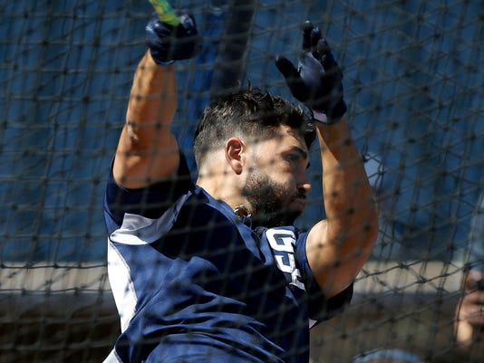 San Diego Padres first baseman Eric Hosmer swings away during batting practice before an opening day baseball game against the Milwaukee Brewers in San Diego, Thursday, March 29, 2018. (AP Photo/Alex Gallardo)