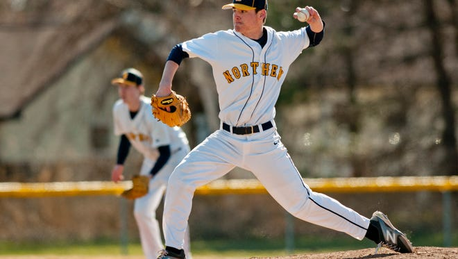 Northern's Brett Manis throws a pitch during a baseballl game Wednesday, April 15, 2015 at Port Huron Northern High School.