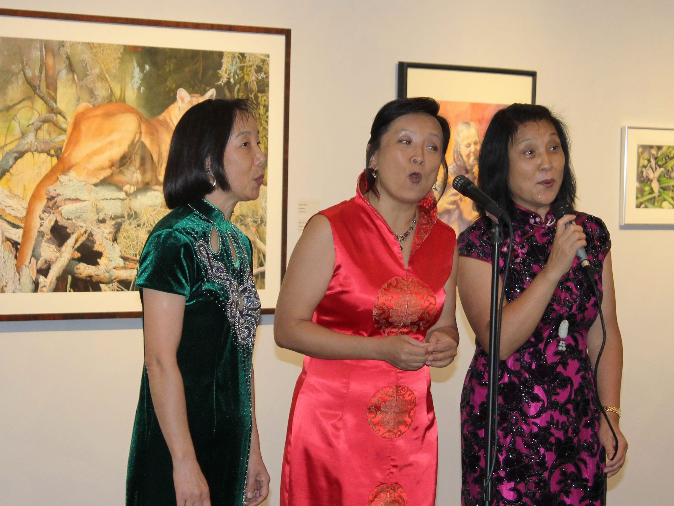 A group of Chinese singers performs traditional Chinese music.